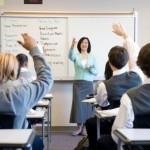 Teacher with hands raised